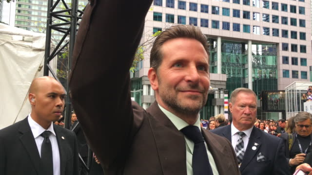 Bradley Cooper actor and director in the movie A Star is Born greets fans in the red carpet event outside the Roy Thomson Hall in the downtown...