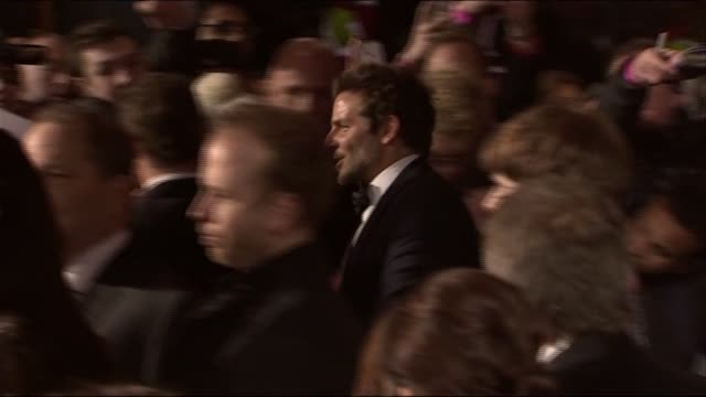 Bradley Cooper arrives at the BAFTAs 2014 he meets hugs and poses for a photo with Michael Fassbender