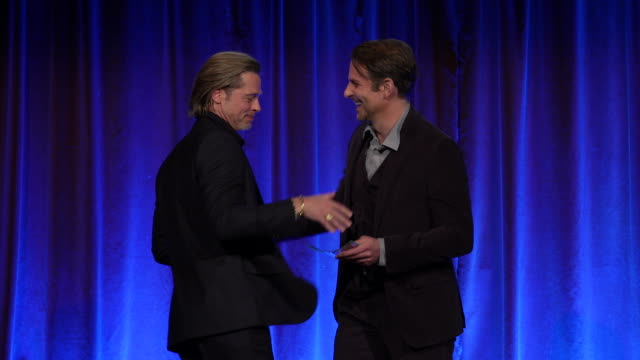 bradley cooper presents brad pitt with award, pitt says he got sober because of cooper, jokes that it's nice to leave this event carrying something... - ジョージ・クルーニー点の映像素材/bロール
