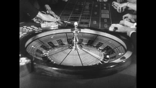 stockvideo's en b-roll-footage met e r bradley's beach club couple walking in roulette wheel turning chauffeur walking in beach club parking lot luxury cars wealth - 1937