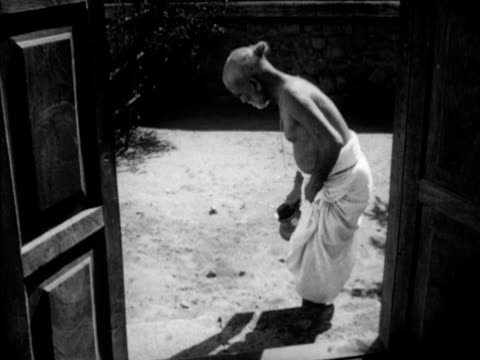 Brahmin Pandit Rama Shastri walking into house rinsing feet on steps Ritual for food consumption Blessing eating from banana leaf without touching...