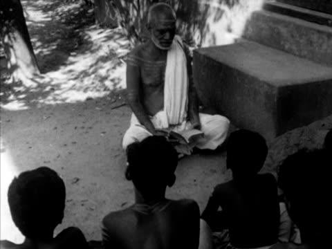 Brahmin Pandit Rama Shastri walking to waiting boys VS Rama Shastri reading Hindu religious book VS Seated boys in bodypaint listening Brahmin...