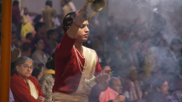 Brahmin Priest with bell and smoke pot