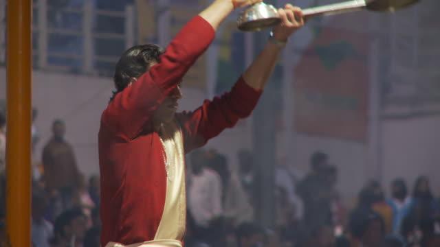 Brahmin priest with  kapoor lamp