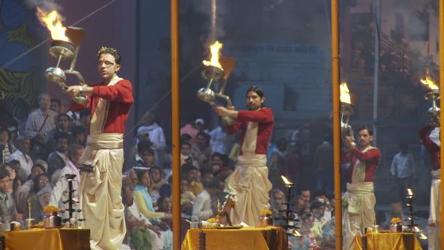Brahmin priests with  kapoor lamp