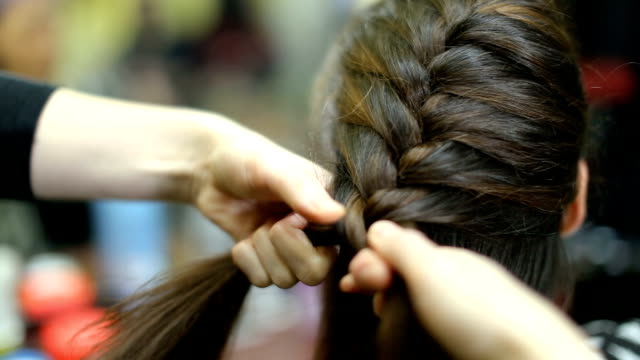 braided hairstyle for beautiful brunette - weaving stock videos & royalty-free footage