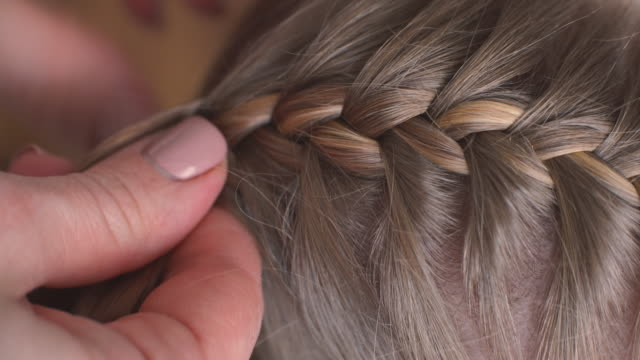 braided hairstyle for girl - weaving stock videos & royalty-free footage