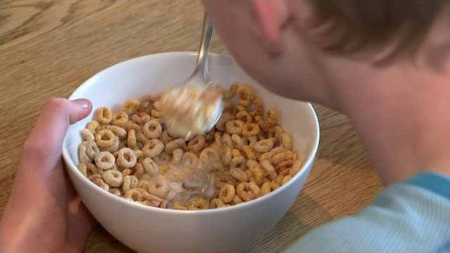 brain abnormality accounts for aversion to loud eaters brain abnormality accounts for aversion to loud eaters t03011720 / 312017 int anonymous boy... - breakfast cereal stock videos & royalty-free footage
