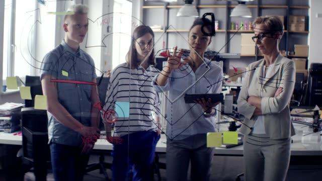 brainstorming during team meeting. startup company - gesturing stock videos & royalty-free footage