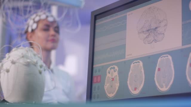 brainwave scanning headset test in laboratory - neuroscience stock videos & royalty-free footage