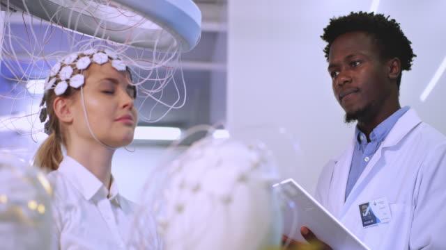brainwave scanning headset test in laboratory. - human brain stock videos & royalty-free footage