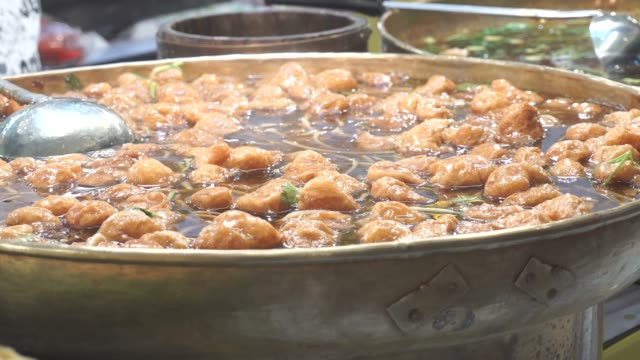 braised fish maw in red gravy soup, famous street food in thailand - braised stock videos and b-roll footage