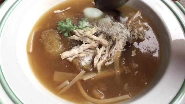 braised fish maw in red gravy soup - braised stock videos and b-roll footage