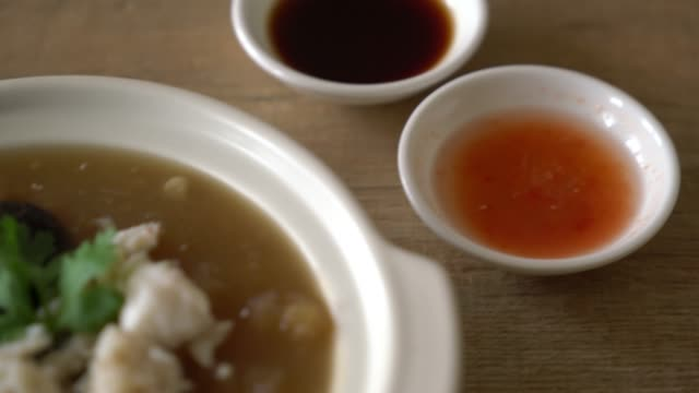 braised fish maw in red gravy soup with crab - braised stock videos and b-roll footage