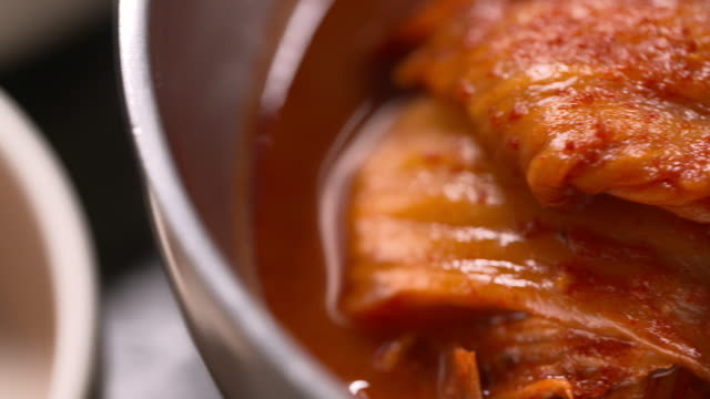 braised kimchi (or kimchi jjim) in the bowl (korean food) - braised stock videos and b-roll footage