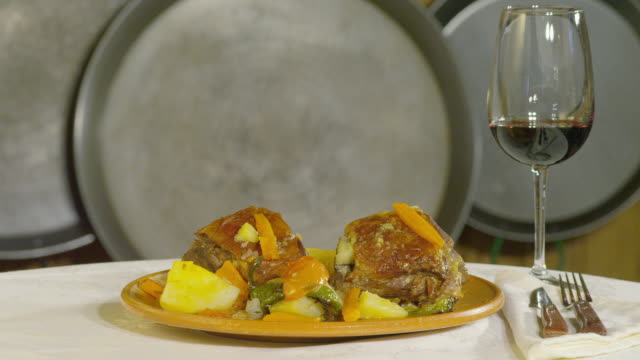 zi braised lamb, a traditional spanish dish and a glass of wine - braised stock videos and b-roll footage