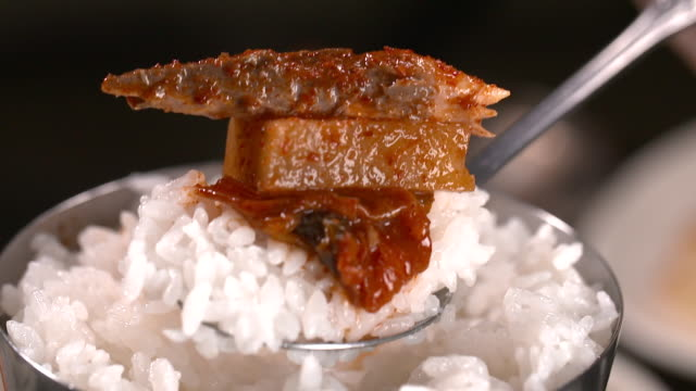 braised mackerel with kimchi on rice (korean food) - braised stock videos and b-roll footage