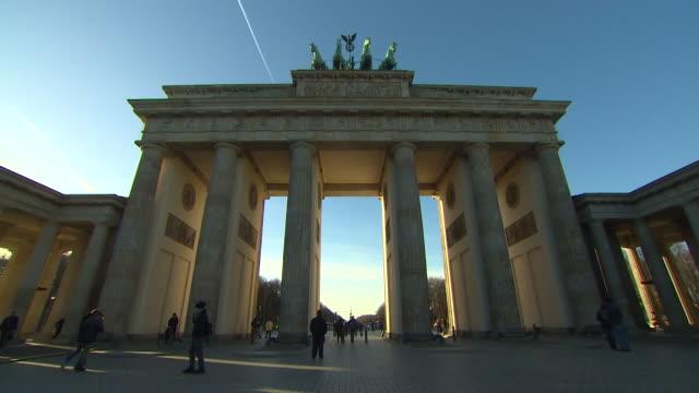 Brandenburg Gate in Berlin tourists milling around