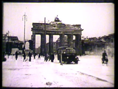 brandenburg gate in berlin w/ few pedestrians automobiles ms united states government issue men walking toward red cross club int vs males reading... - red cross stock videos & royalty-free footage