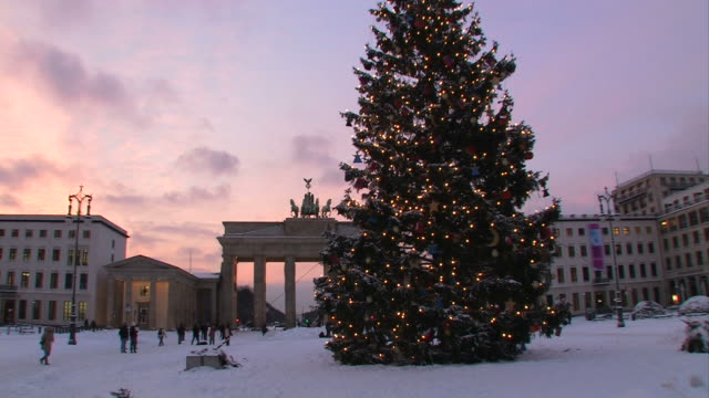 brandenburg gate with a christmas tree - wintertime - christmas tree stock videos & royalty-free footage