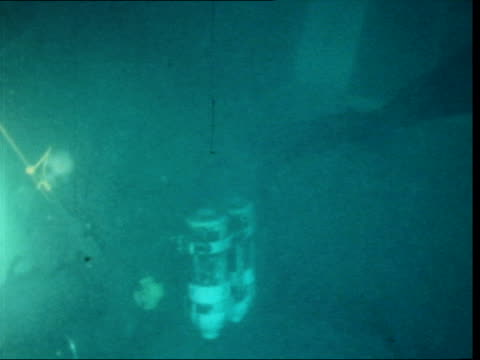 vídeos de stock, filmes e b-roll de 'brandenburg' ship wreck investigation england english channel ext two buoys pull out to dinghy various shots divers putting on equipment man in boat... - compasso