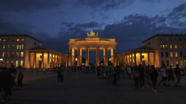 Brandenburger Tor illuminated with pedestrians and tourist. Berlin, Germany, Europe.