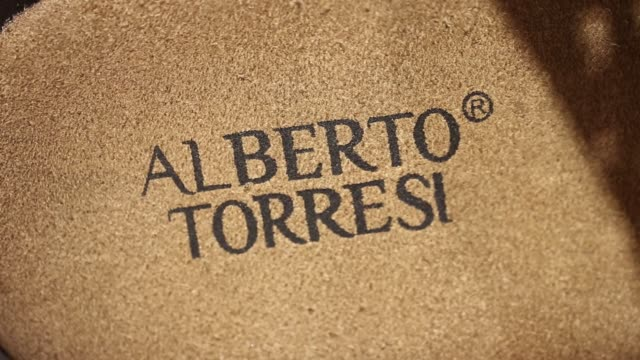 CU branding for Alberto Torresi is seen on a product displayed in a retail showroom at Virola Shoes Pvt's manufacturing facility in Agra Uttar...