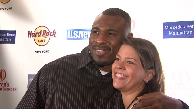 brandon jacobs and wife at the tiki rocks the square for children's miracle network at the hard rock cafe in new york, new york on may 10, 2007. - hard rock cafe stock videos & royalty-free footage