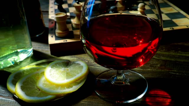 brandy and chess - brandy snifter stock videos & royalty-free footage
