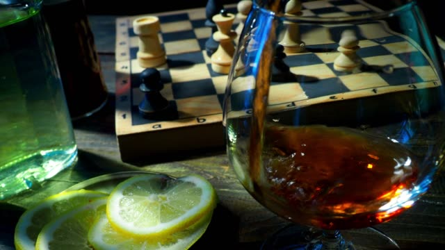 brandy and chess - brandy snifter stock videos and b-roll footage
