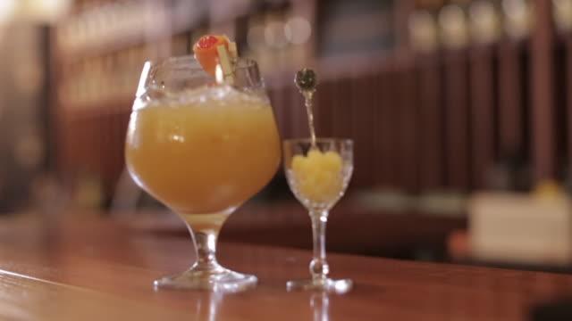 brandy cocktail served with pineapple - bar点の映像素材/bロール