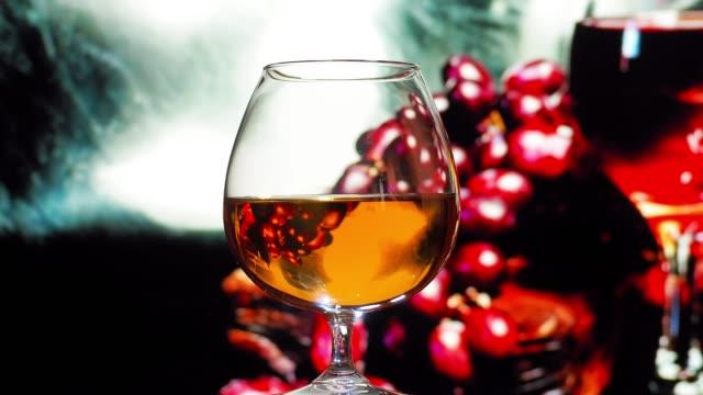 brandy drinking in night bar - brandy snifter stock videos & royalty-free footage