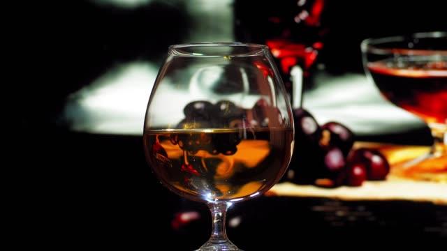brandy drinking in night bar - brandy snifter stock videos and b-roll footage