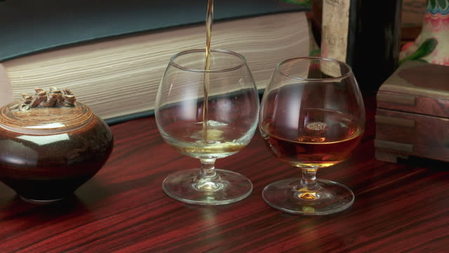 CU Brandy pouring in glasses
