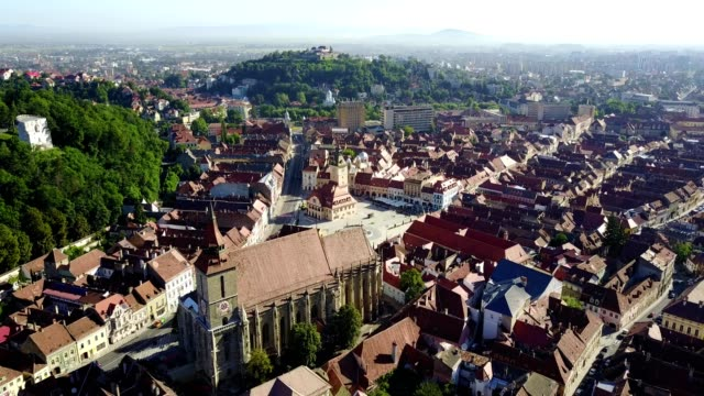 brasov overflight towards blach church - romania stock videos & royalty-free footage