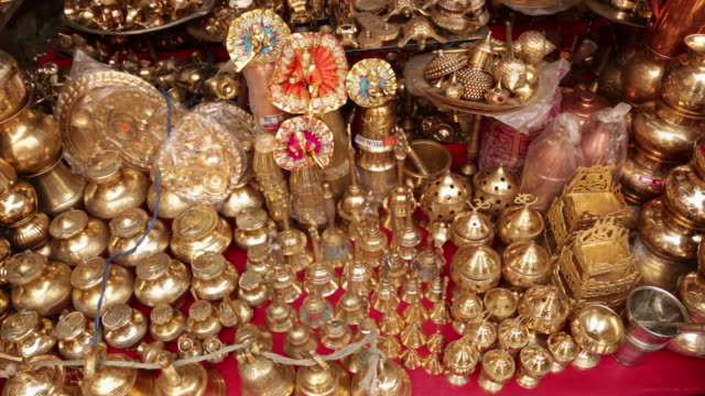 brass articles on display in a market stall, haridwar, uttarakhand, india - brass stock videos & royalty-free footage
