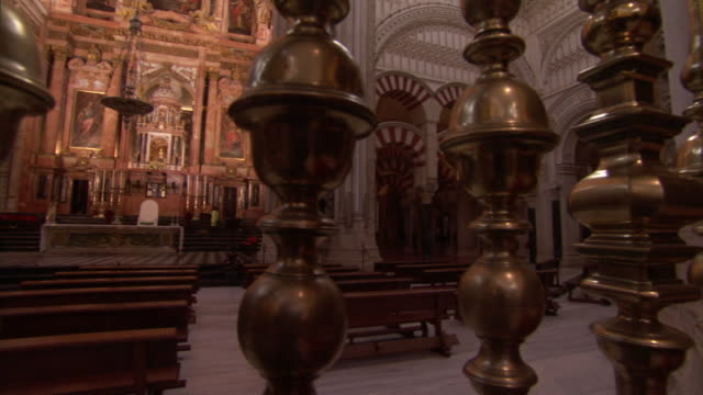 a brass balustrade encloses a chapel within the mosque-cathedral of cordoba. - chapel stock videos & royalty-free footage