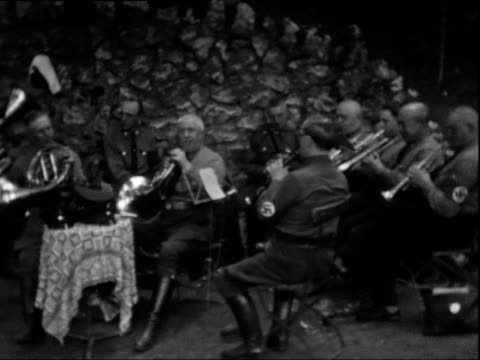 a brass band of old man all with nazi swastika armband emblem on their arms play camera pans - nazi swastika stock videos and b-roll footage