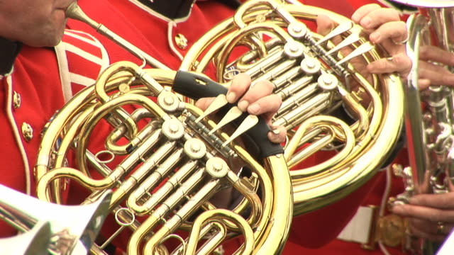 brass band playing french horn - hd & pal - french horn stock videos and b-roll footage