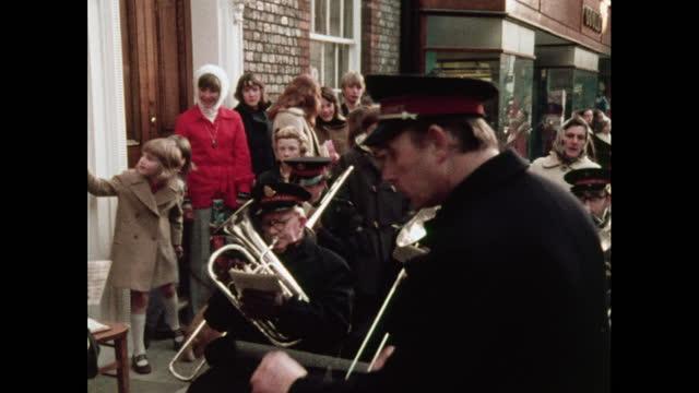 brass band plays 'jingle bells', 1970s - ブラスバンド点の映像素材/bロール