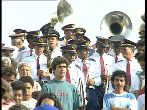 brass band walking down steps in street procession ouro preto brazil - ブラスバンド点の映像素材/bロール