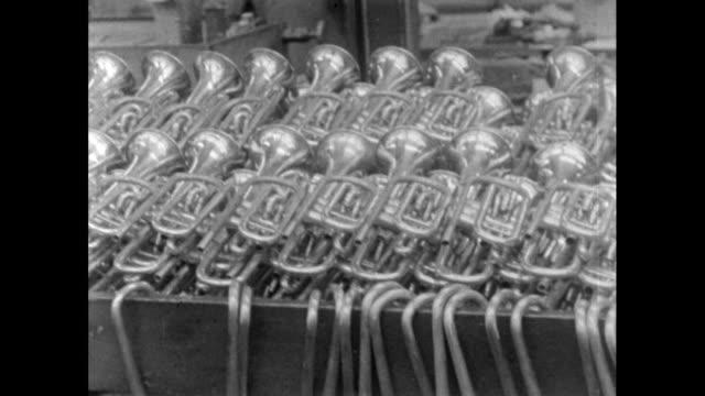 brass instruments in factory; 1956 - 1956 stock-videos und b-roll-filmmaterial