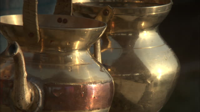 brass kettles, varanasi available in hd. - metal stock videos & royalty-free footage