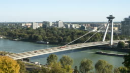 Bratislava aerial cityscape timelapse side view of transportation on famous view-point,UFO Observation Deck, and high way road to go to the old town on the sunny weekend day of summer in Slovakia. Concept of city life view with copy space.