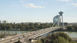 Bratislava aerial cityscape timelapse view of transportation on famous view-point,UFO Observation Deck, and high way road to go to the old town on the sunny weekend day of summer in Slovakia. Concept of city life view with copy space.
