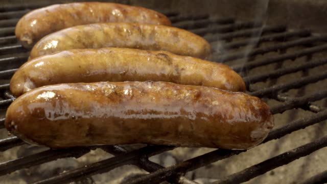 bratwurst on a flaming grill - german culture stock videos & royalty-free footage