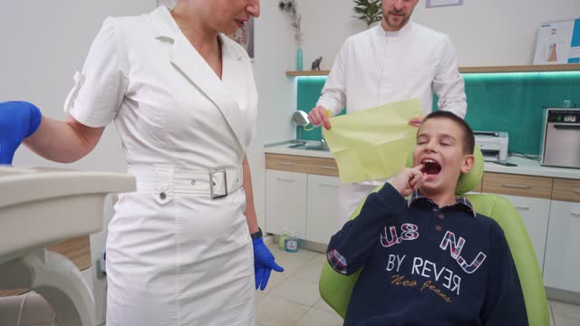 brave boy showing which tooth it hurts at the dental appointment - 10 11 years stock videos & royalty-free footage