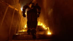 Brave Fireman Runs Up the Burning Stairs. Fire is Everywhere. In Slow Motion.