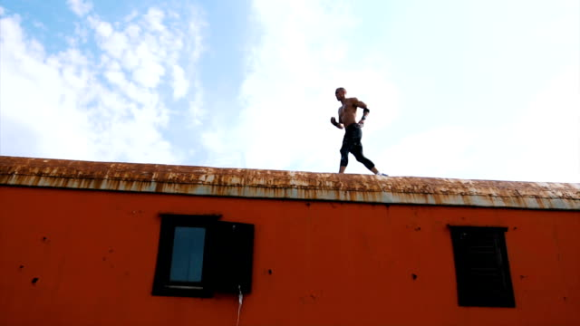 brave man jump between two train wagons - tracksuit bottoms stock videos & royalty-free footage