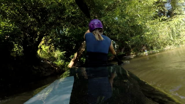 brave young sport woman paddling kayak in the jungle - canoe stock videos & royalty-free footage